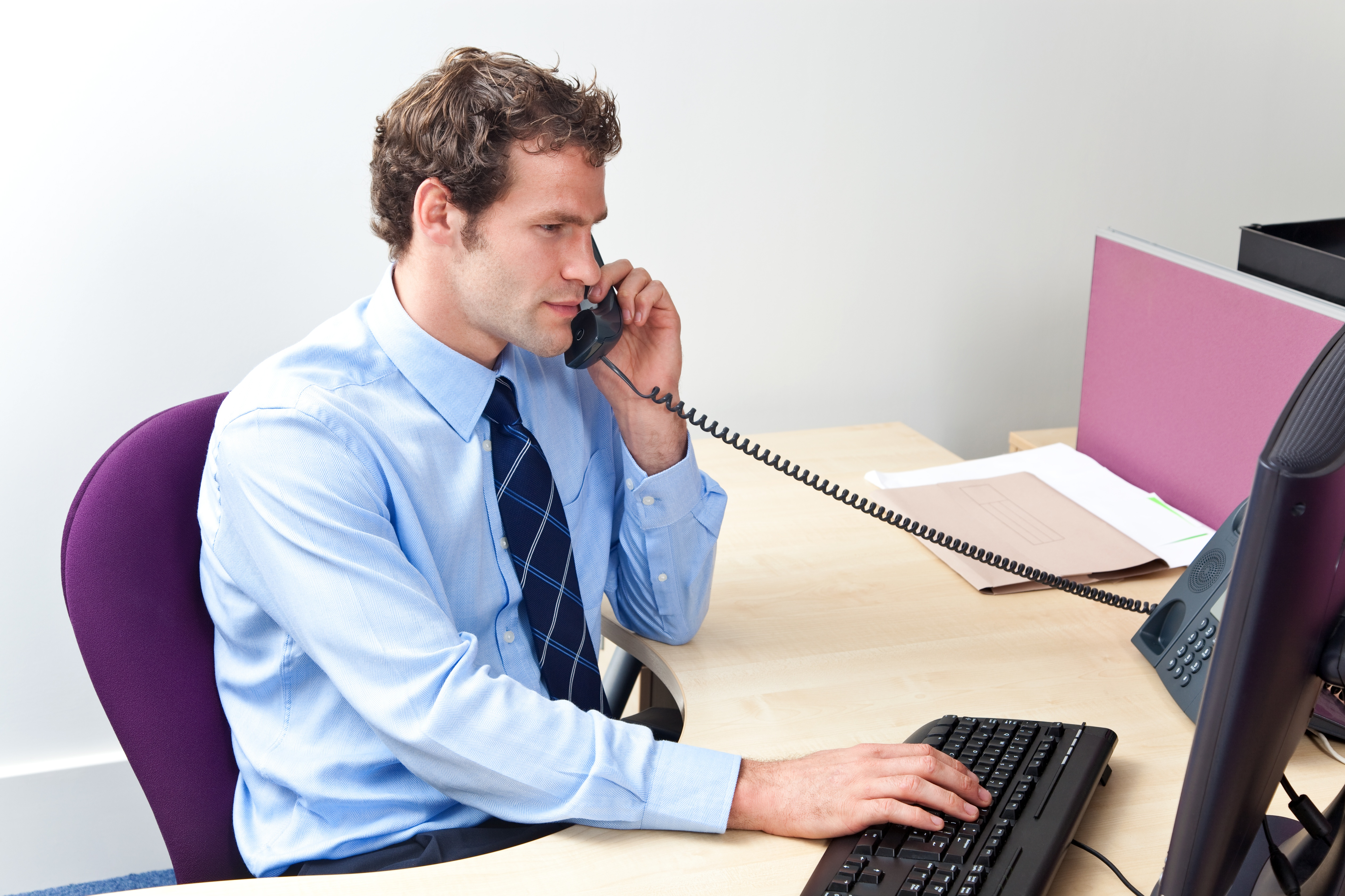 bigstock-Customer-Care-Worker-In-An-Off-7006452.jpg